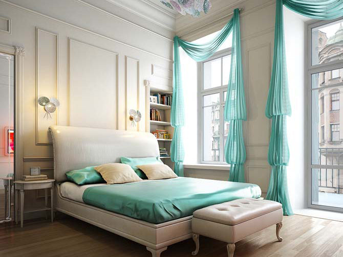High ceiling cream bedroom in a city apartment, with teal accent colours