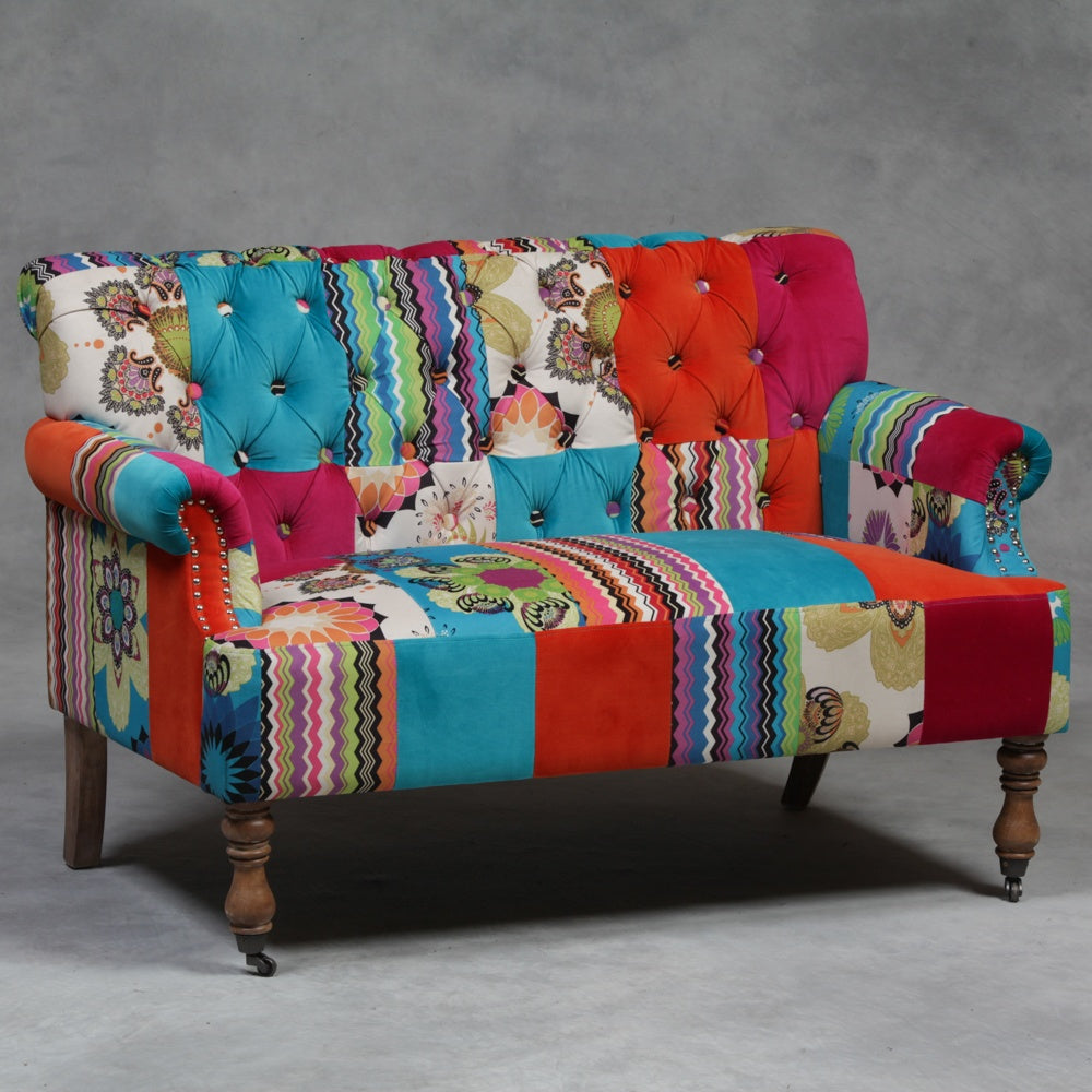 A patchwork upholstered sofa, in ref, turquoise and other floral patterns