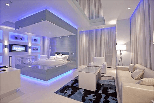 Luxury white and silver bedroom with light blue mood light around the room