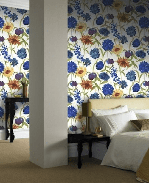 Cream, blue, and yellow wallpaper in a bedroom with double bed