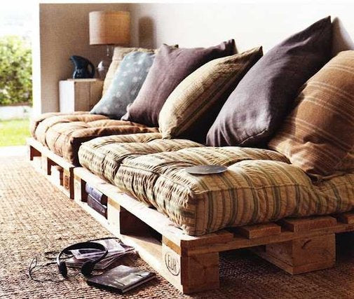 DIY pallet sofa with garden chair cushions and scatter cushions on top