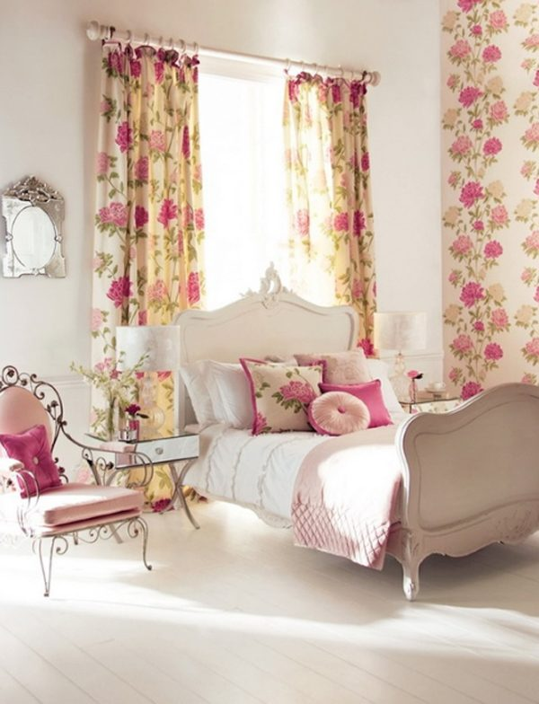 Cream bedroom with cream and pink floral curtains and matching wallpaper
