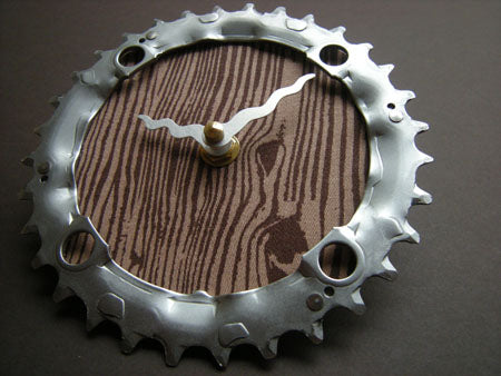 A bicycle gear cog used to create a decorative wall clock