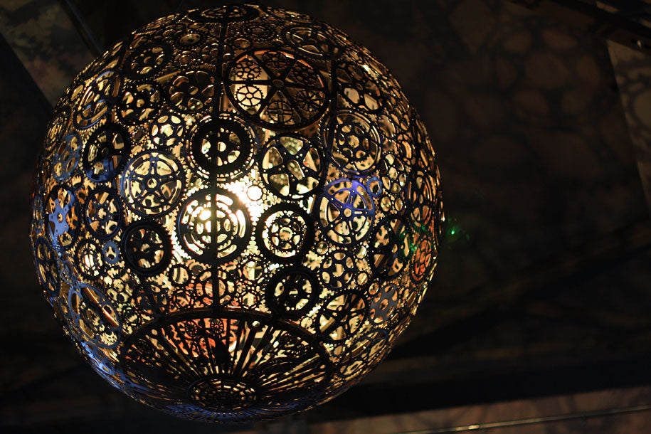 Spherical light fixture made from lots of cogs and gears