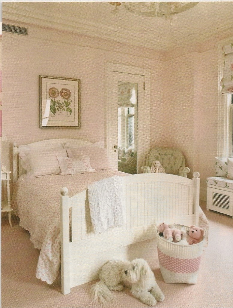 Light pink and cream double bedroom with soft toys in the room, and fluffy white dog
