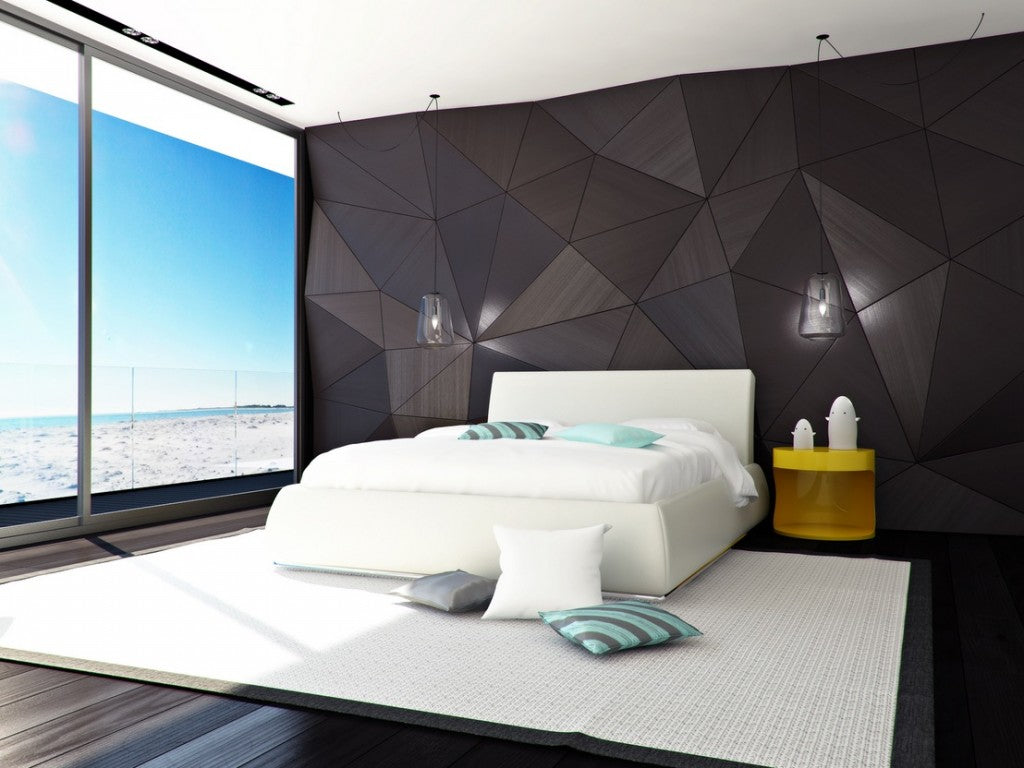 Penthouse style bedroom with geometric shaped 3D wall and floor to ceiling glass window looking at the beach and sea
