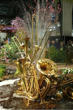 Brass band themed water feature with water shooting out of different brass instruments