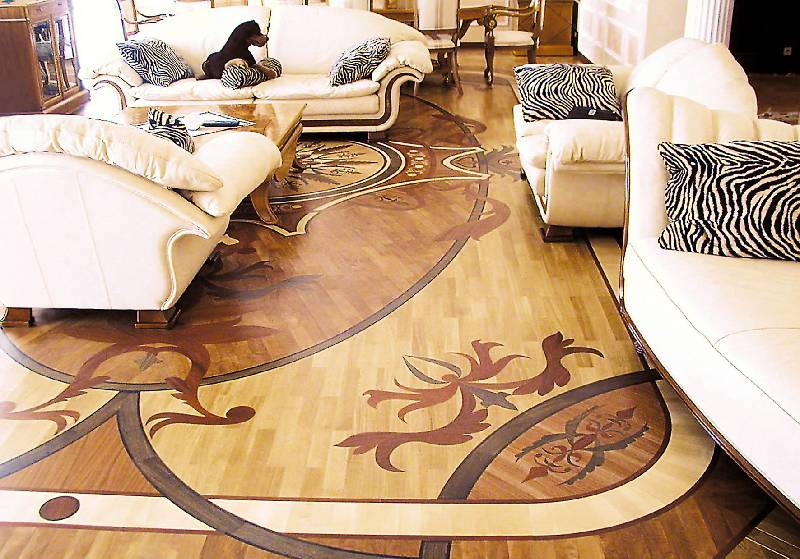 A stunning wooden floor with decorative design that resembles a coat of arms