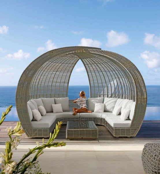 Large spherical enclosed wicker outdoor seating area