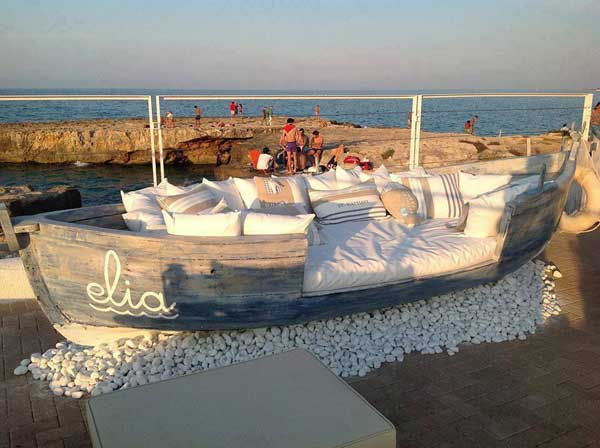 Re-purposed boat turned into a daybed by the sea