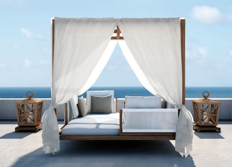 Four poster day bed overlooking the sea
