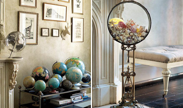 A series of different shaped globes sitting on a coffee table