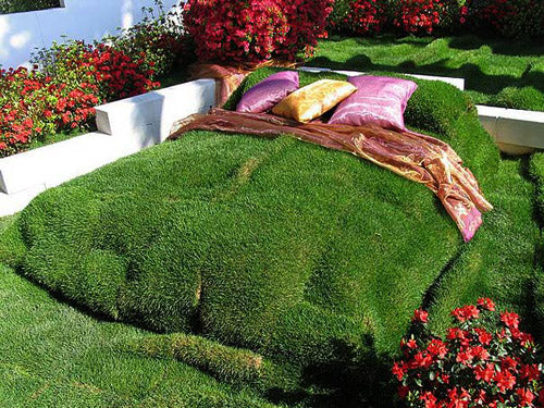 Soil built up into a raised platform then covered in real grass turf, to look like a bed