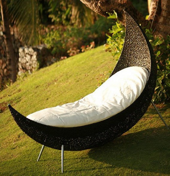 Moon shaped wicker day bed, also looks like a canoe