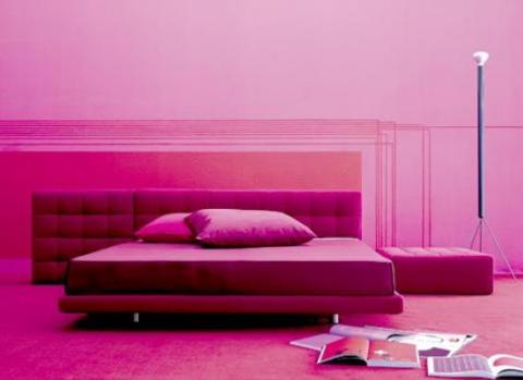Pink bedroom with pink walls and dark pink headboard and pink carpets