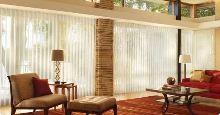 white vertical blinds in large living space, covering floor to ceiling windows