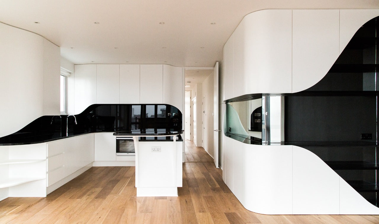 Light wooden floors and white units in a modern and clean kitchen