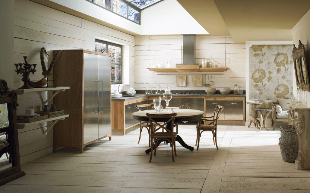 Modern kitchen with real wooden floors, metallic unit doors and skylight the full length of the kitchen