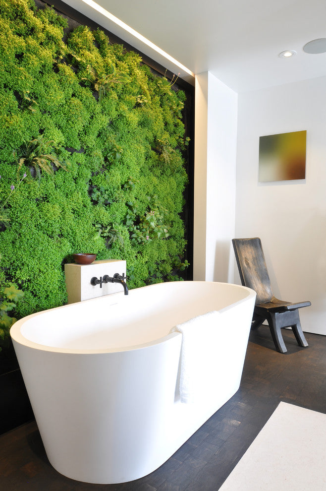 Modern White Bathtub In Front Of A Wall Of Green Shrubbery