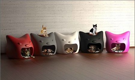 Plastic cat beds in different colours, in the shape of a cat head