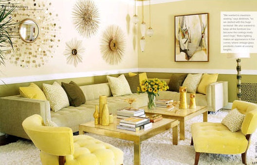 A light beige, sage green and yellow living room with a big corner sofa