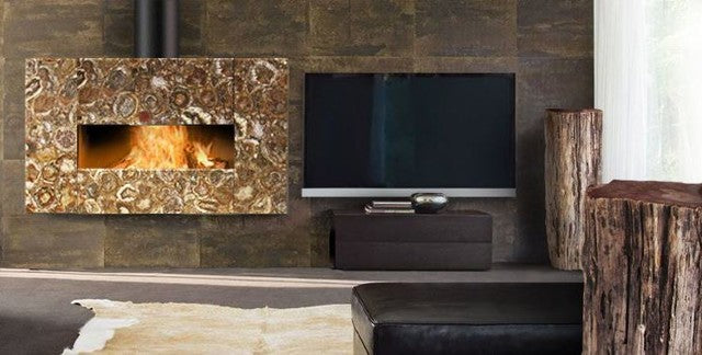 Dark brown tiles on a wall, with large rectangular gas fire, suspended from the ceiling by a black pipe in a modern living room