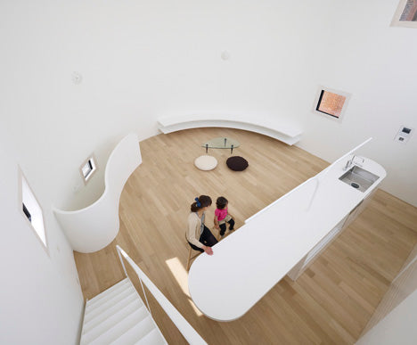 Birds eye view of a white and light wood living space