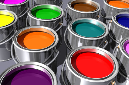 Open paint tins containing a number of different colours