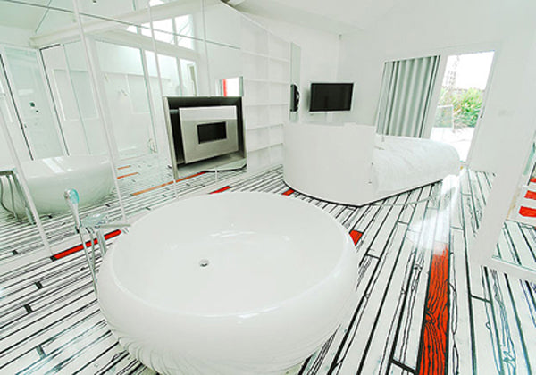 Modern white luxury living space with printed flooring that looks like white and red floorboards