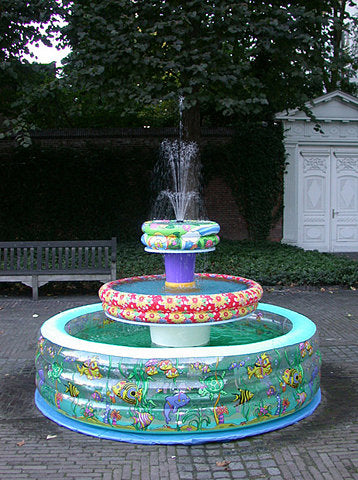 Inflatable paddling pools in three tiers create a garden water fountain