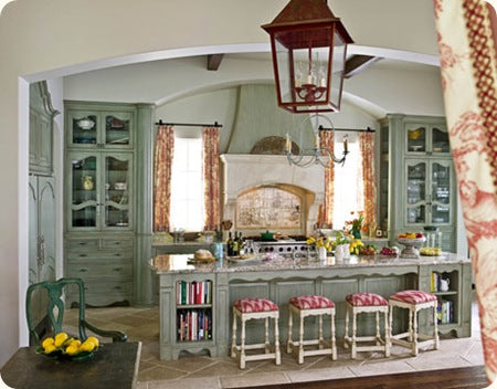 French style country kitchen with greyish green kitchen units and large kitchen island and breakfast bar