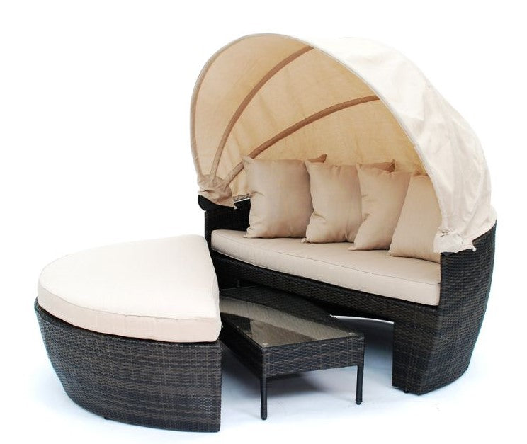 Black woven garden furniture with cream seatpads and convertible style roof