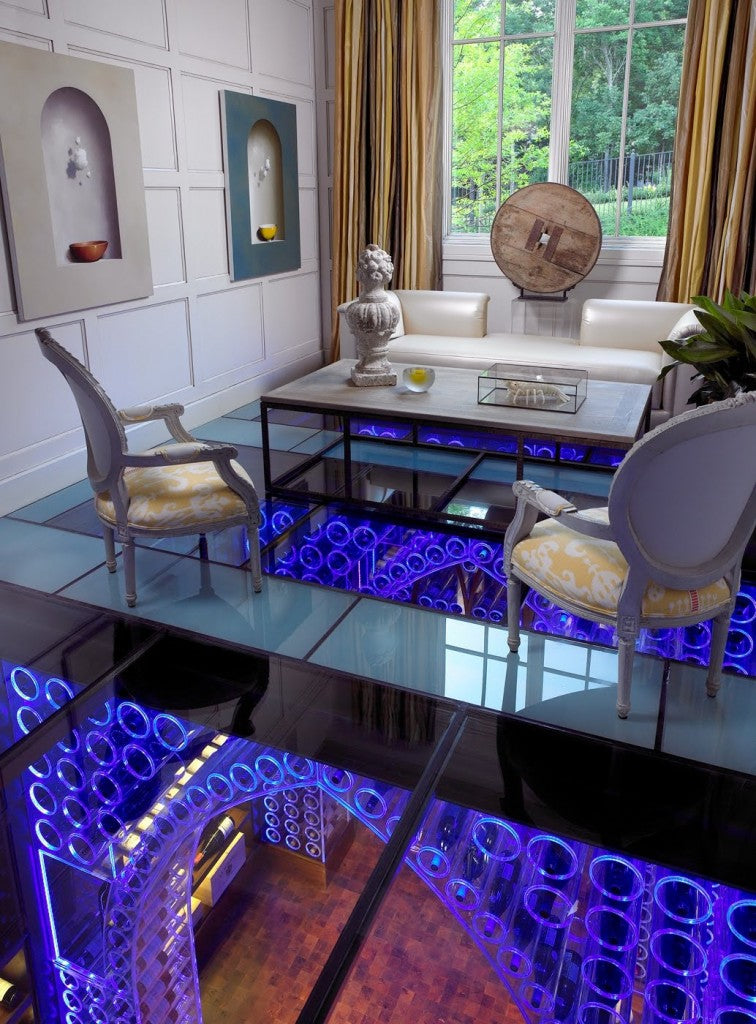 Living room and sitting area with glass floor, with a modern wine cellar below