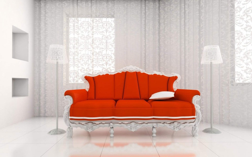 White living room with white voile panels in the background, and a white wooden sofa with orange/red cushion pads