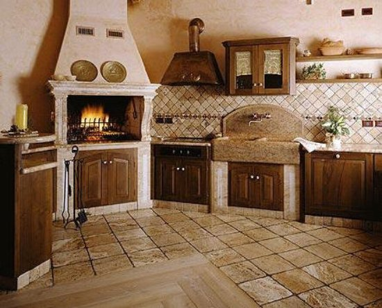 Beige and brown country kitchen with dark wooden units and natural coloured floor tiles