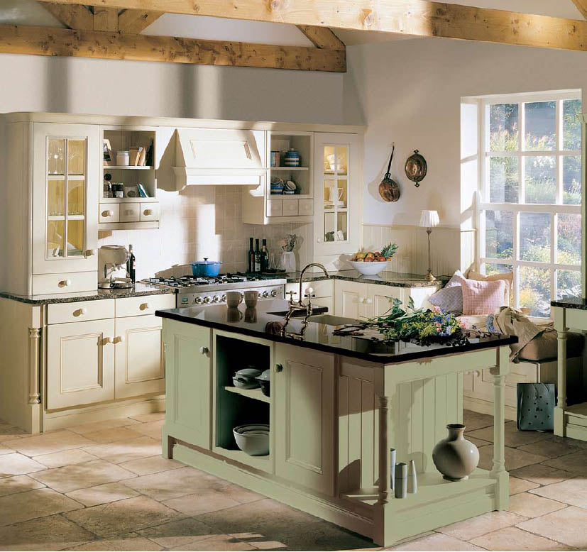 Cream and sage green country kitchen with stone flooring and exposed ceiling beams