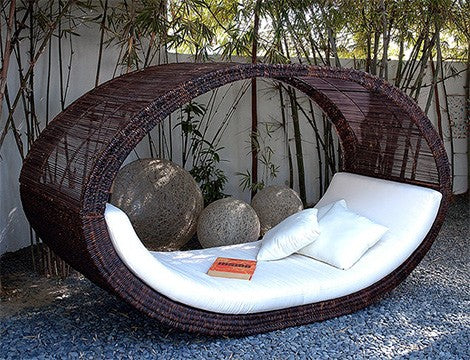 Wicker frame oval shaped day bed, with white cushion pad