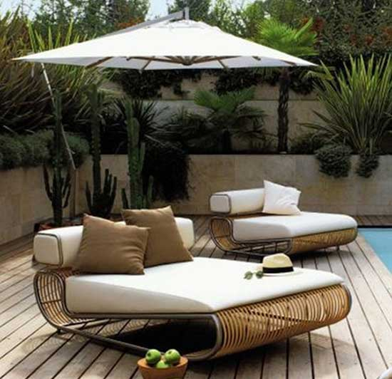 Cosy sun lounger day beds by the side of the pool