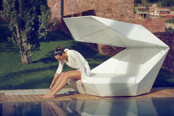 Geometric white pod day bed with angled corners and flat surfaces