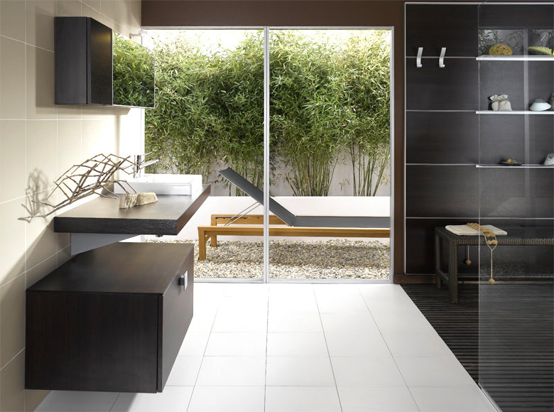 White Floor Tiles Meet A Black Tiled Walk In Bathroom
