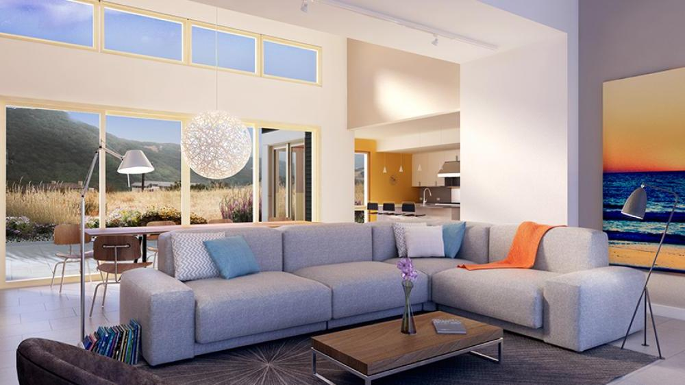Large living space with high ceilings, large grey corner sofa and large sliding doors open to a lovely hillside view