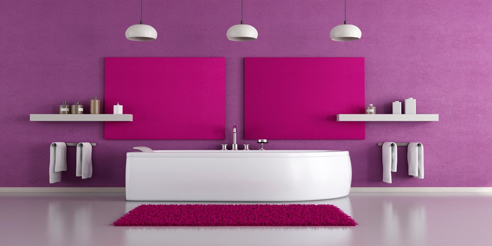 White floor and white bathtub, then purple and pink walls and purple bathroom rug
