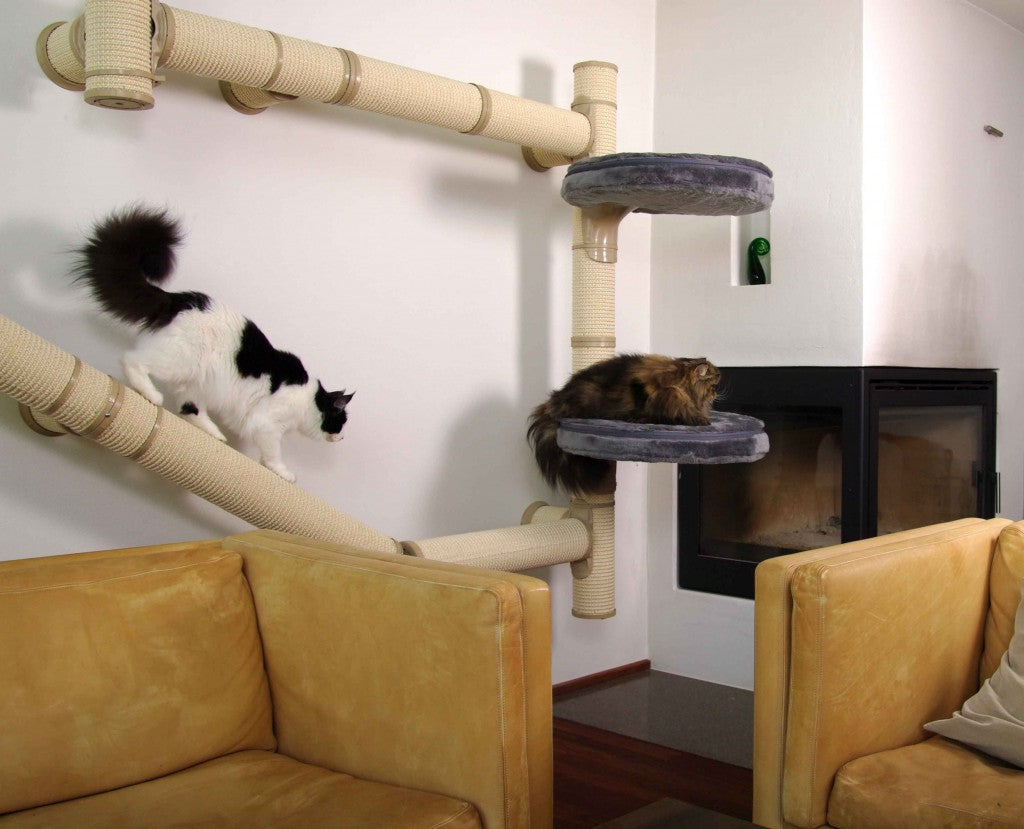 Wall mounted round tubes covered in material, used as a climbing frame for cats in a living room