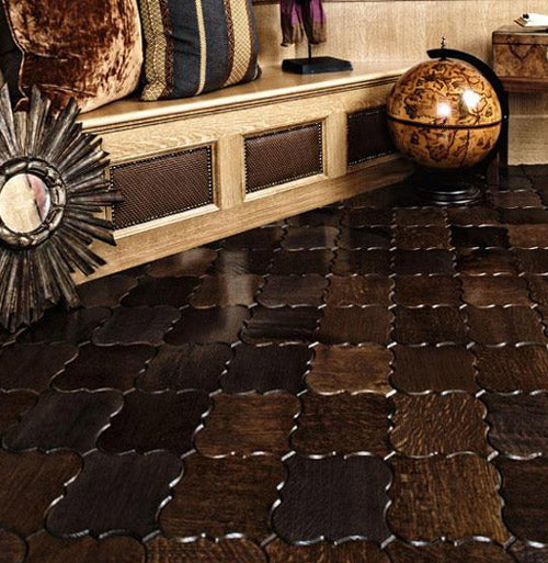 Ornate swirling squares of dark wood join together to make a stylish wooden floor