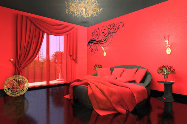 Black and dark red bedroom with red cushions and blanket on a black bed