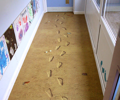 A sand resin floor with childrens footprints shaped into the floor