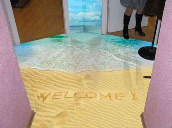 Printed PVC flooring that looks like a beach and the sea crashing onto the shore