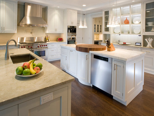 Large modern kitchen in white, silver and cream and dark wood finish flooring