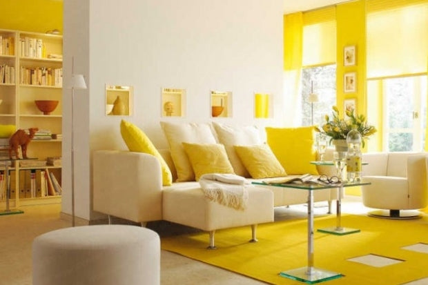 Cream and yellow living room with yellow cushions on a cream sofa and yellow rug and yellow window blinds
