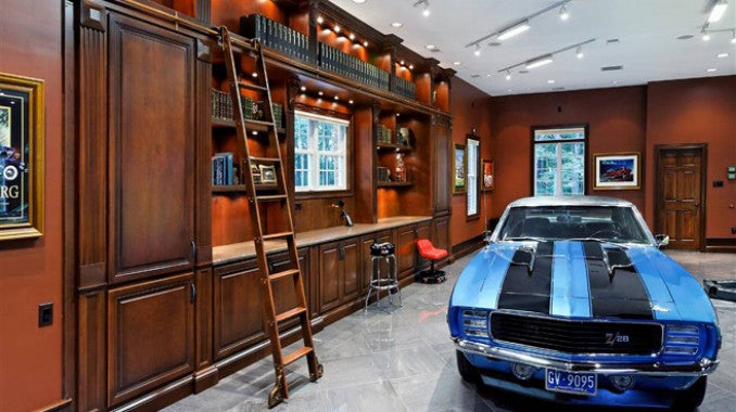 Blue sports car in a wooden and dark orange library within the home